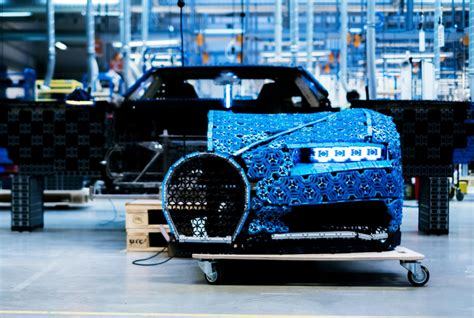 That's not quite a patch on the real bugatti chiron's absurd 420km/h top speed, but considering it's achieved through just power functions motors, it's still of course, the massive amount of engineering that went into creating this behemoth wasn't for nought:lego technic 42083 bugatti chiron is. LEGO create a drivable Bugatti — Born to Engineer