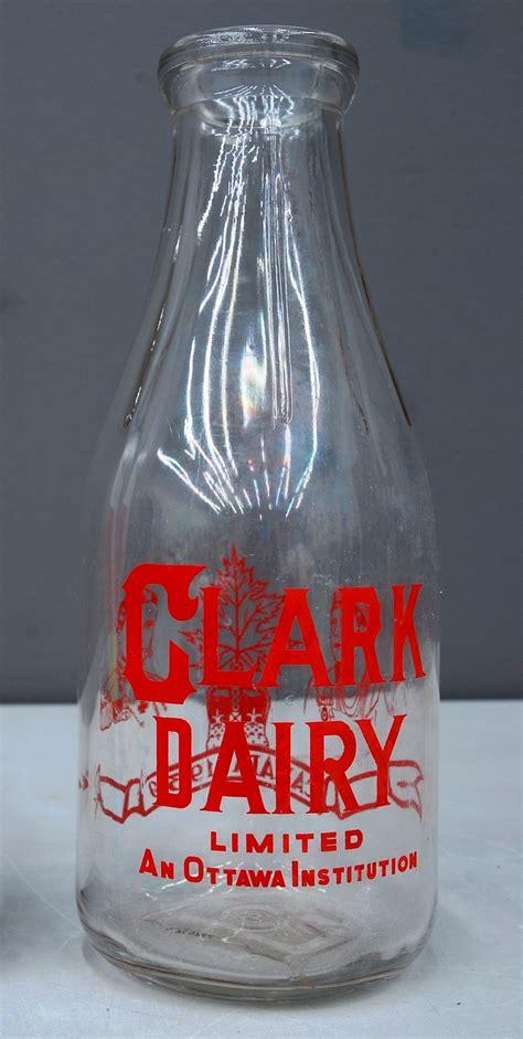 clark dairy  qt milk bottle   dominion glass