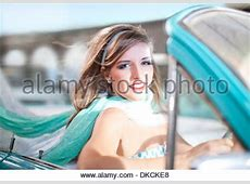 1950s SMILING PORTRAIT BRUNETTE WOMAN LOOKING AT CAMERA HOLDING Stock Photo 47225006 Alamy