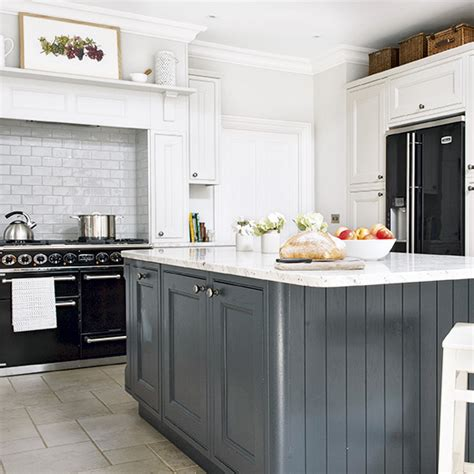 Country Kitchen With Grey Island And Black Range Cooker