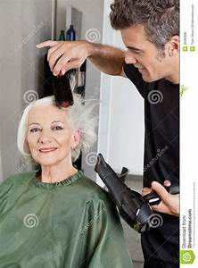 Hairdresser Blow Drying Woman's Hair Stock Image - Image ...