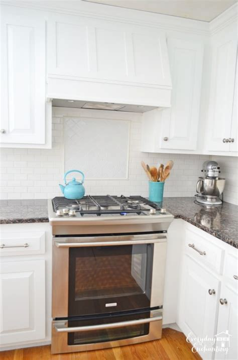remodelaholic white kitchen overhaul  diy marble island