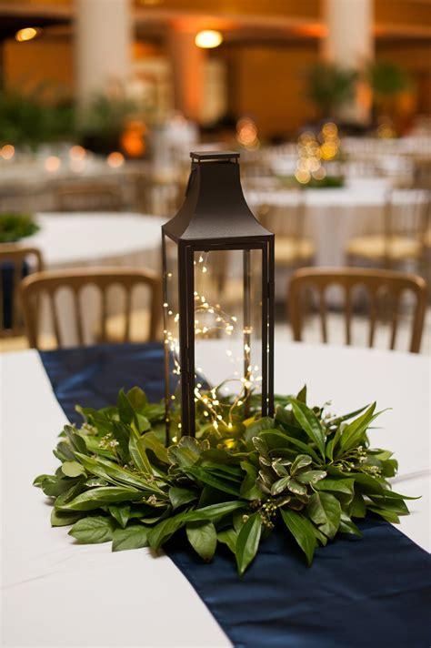 lantern centerpiece  simple greenery