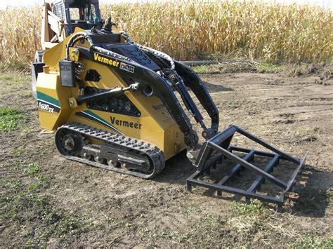 rake landscaping skid steer attachment daniel mfg