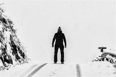 man standing  white snow covered ground  mountain
