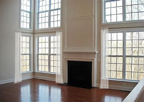 How To Dress Awkward Windows + Where To Shop For Readymade Options Ceiling Mounted Curtain Rods Bay Window Purple And Grey Blackout Curtains Round Shower Rail Uk Diy Tiffany Green Types Of Fabric Wall Corner Detail Revit Windows
