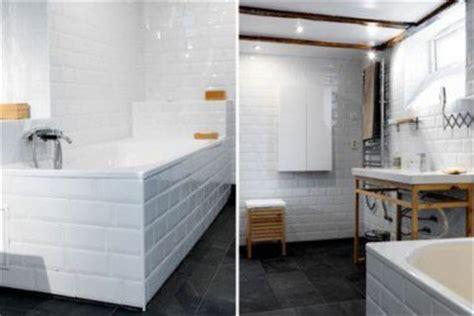 salle de bain carrelage blanc sur murs et tablier baignoire