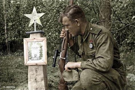 Ivan Lebedev sniper kneeling on the grave of his fallen ...