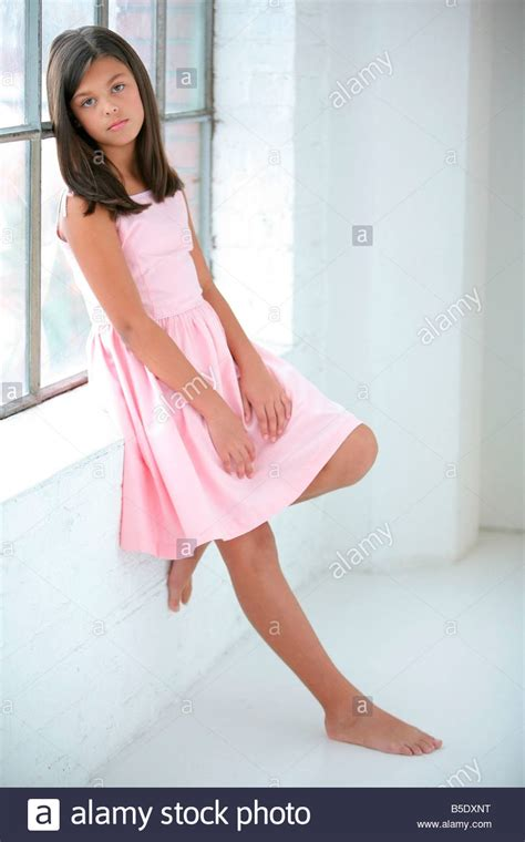 Preteen girl wearing a pink dress Stock Photo, Royalty ...