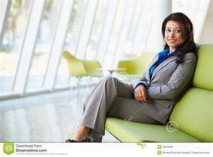 Portrait Of Businesswoman Sitting On Sofa In Modern Office ...  Sitting
