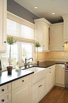 wood kitchen backsplash how the wainscotting backsplash makes the look less 1136