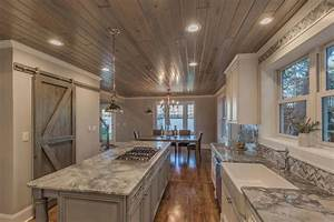 Traditional Kitchen with Hardwood floors & High ceiling in