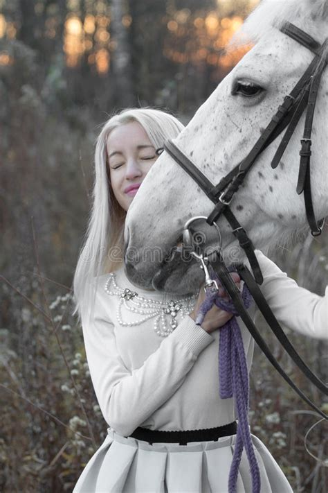 blonde each horse eyes looking brunette into standing background alluring