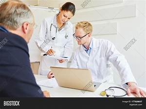 Doctors giving advice to patient about diagnose and ...