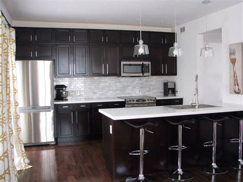 white kitchen cabinets and black countertops kitchen with cabinets and white quartz counters and 2049