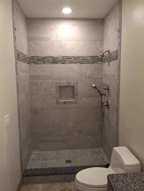 grey wall tiles shower niche  mosaic floor