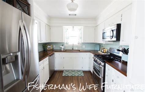 space between kitchen cabinets and ceiling how to cover space above cabinets