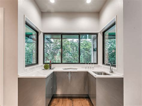 black windows create bold contrast  compact kitchen pella