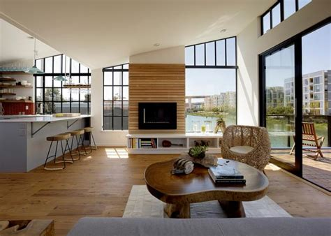 floating house living room  water view hgtv