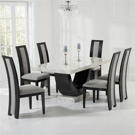 marble dining set in and black with 6 grey