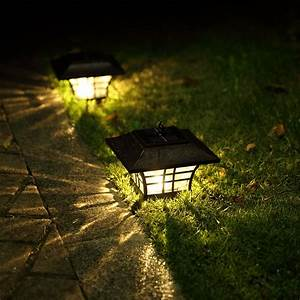 Stone Walkway And Black Ornate Outdoor Solar Light