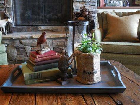 Male hands put a tray with a cup of coffee, cookies and chocolate on the table. 7 Ways to Decorate with Trays | Home..ideas | Decorating coffee tables, Home Decor, Decor