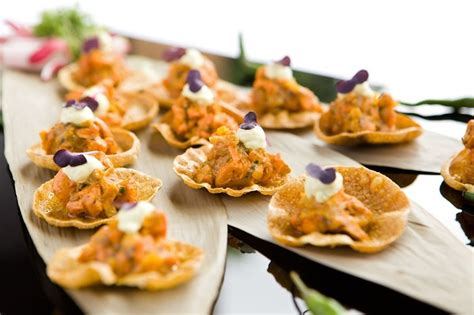 indian canapes ideas mini poppadums with chicken tikka canapés prepared by the