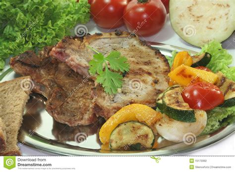 pork chop grill time grilled pork chop stock photo image of vegetables onion 15173392