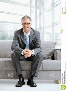 Businessman Sitting On Couch Stock Photos - Image: 11063383