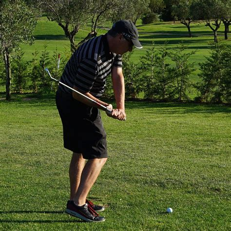 how to swing a golf club how to eliminate early extension in your golf swing golf