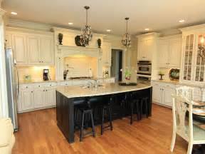 white kitchen black island kitchen