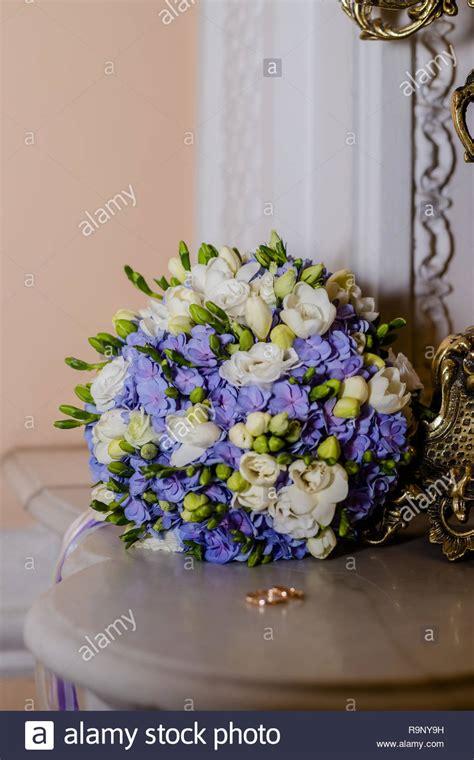 wedding rings lie  beautiful bouquet  bridal
