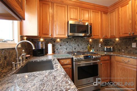 Kitchen Backsplash Pictures With Oak Cabinets by Oak Cabinets With Glass Mosaic Backsplash