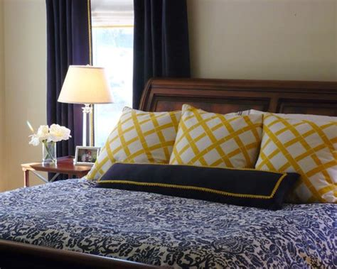 navy master bedroom  yellow accents