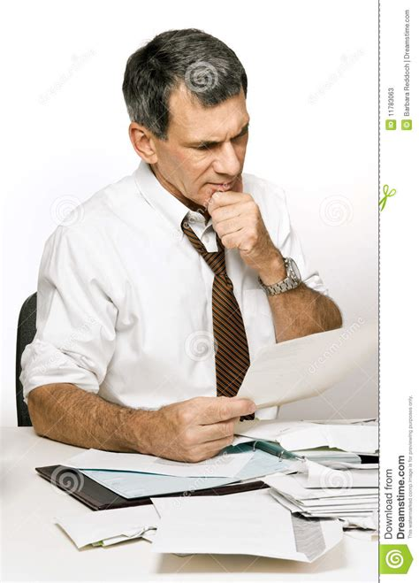 confused man reading  bill  bank statement stock