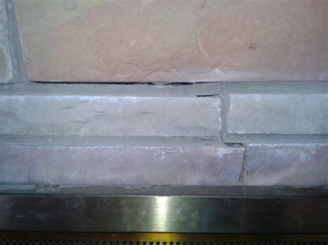 how do i repair this cracked fireplace masonry