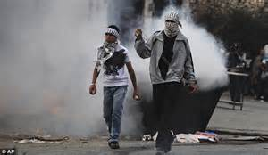 Palestinian protester dragged away by Israeli soldiers in ...