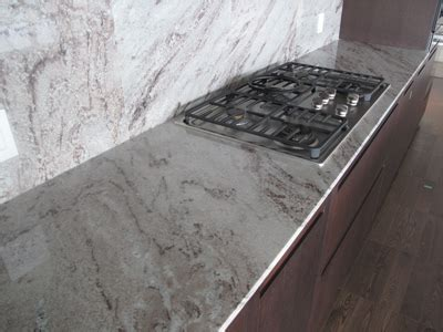 Granite slab kitchen counter tops with full height backspl