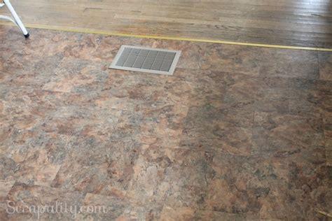 adding peel n stick tiles to the kitchen floor