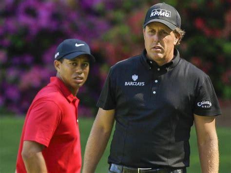 Tiger Woods-Phil Mickelson. Tiger Woods, left, walks ...