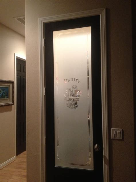 4 Door Kitchen Pantry White Black Door And A Frosted Pantry Door Current Home
