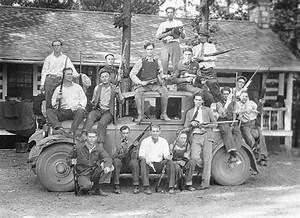 The bootlegger, Charley Birger, (seated, center on car ...