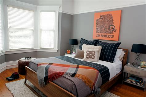 Transitional Bachelor Pad Bedroom With Orange Accents