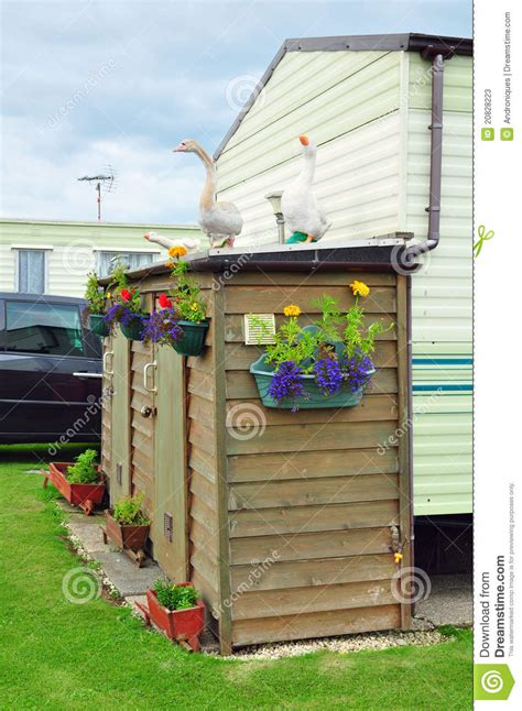 goose shed caravan c shed flowers geese figures stock photos