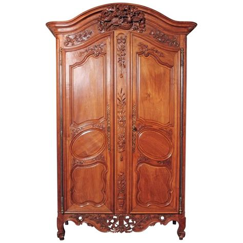 Armoire Provençale by 18th Century French Carved Walnut Armoire From Provence