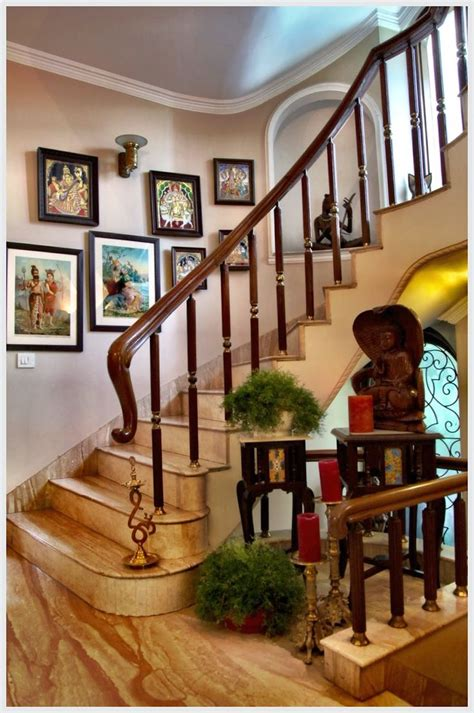 home interior shopping india lining the walls of the stairway are ravi varma lithographs and tanjore paintings that create a