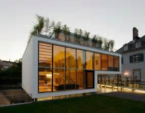 Modern Architectural House Designs by Modern Day Property With Glass Walls And Rooftop Terrace