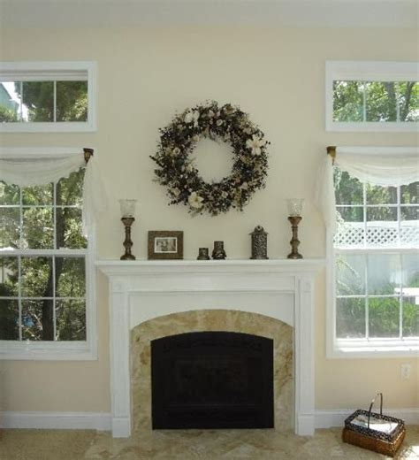 mantel decor  floral wreath  fireplace mantel