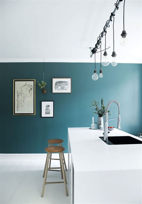 white kitchen  blue accent wall