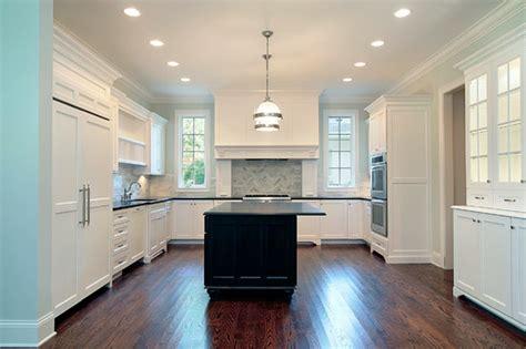 white kitchen cabinets with black granite countertop